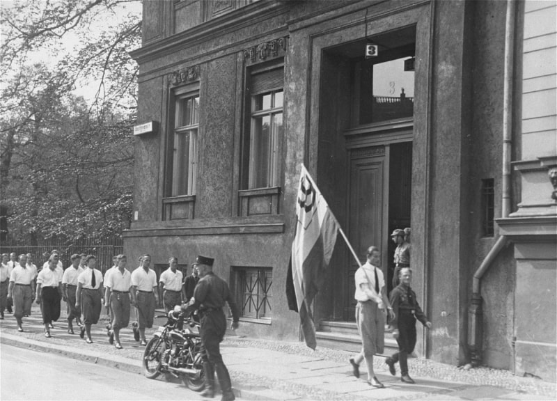 Rowes of German students parade in front of the Institute for Sexual Research building.